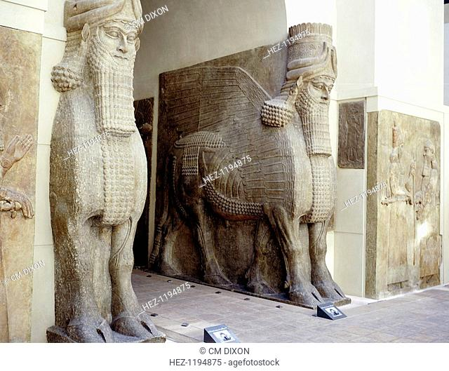 Assyrian sculptures of human-headed winged bulls at the palace gateway, Palace of Sargon II, Khorsabad, c8th century BC. Part of the collection at The Louvre