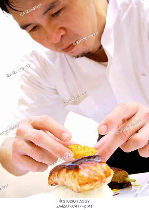 Close-up of a chef preparing food
