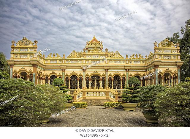 Buddhist temple at the Vinh Trang Temple in Mytho City, Mekong Delta, Vietnam