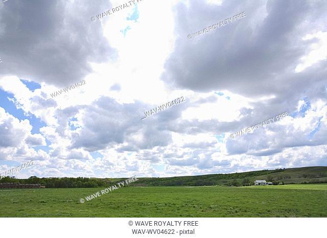Dramatic clouds of green field, Lumsden, Saskatchewan, Canada