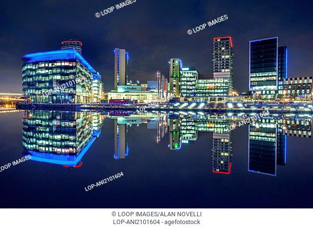The television studios of MediaCityUK reflected in the waters of Salford Quays at night
