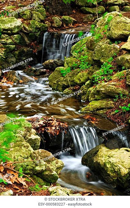 Creek with small waterfalls in Japanese Zen garden