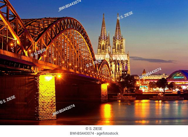 Cologne Cathedral with Hohenzollern Bridge in the twilight, Germany, North Rhine-Westphalia, Cologne