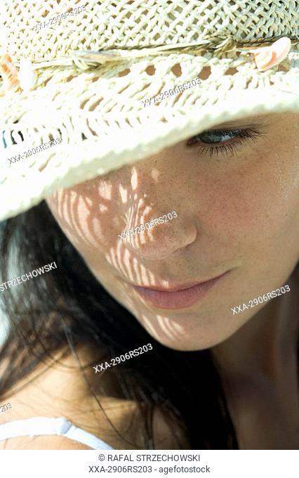 beauty woman in hat on bach