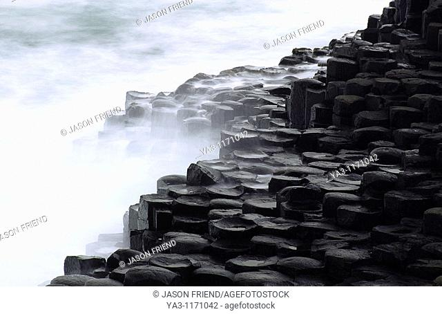 NORTHERN IRELAND, County Antrim, Giants Causeway  Waves crash against the hexagonal basalts rock formations of this world heritage site