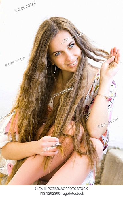 Happy young woman with a beautiful extra long hair