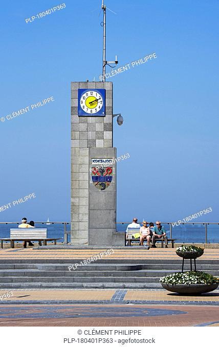 Clock on the promenade at seaside resort Koksijde / Coxyde, West Flanders, Belgium