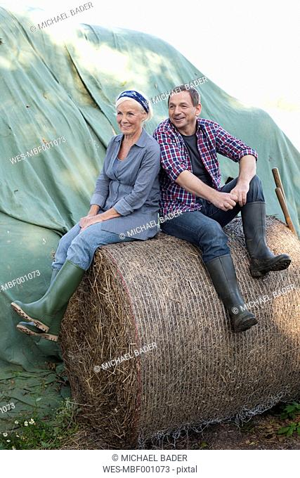 Germany, Saxony, Man and woman at the farm, smiling
