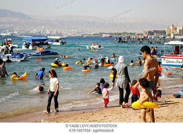 People on the public beach of Aqaba, Jordan