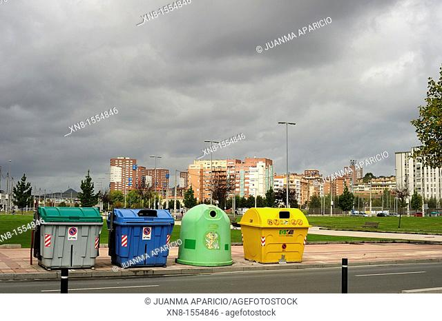 Recycling containers for refuse in front of a modern urban neighborhood Barakaldo