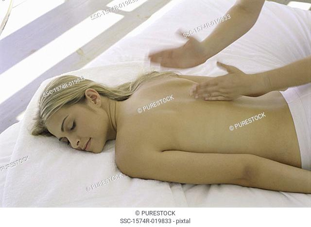 High angle view of a young woman getting a back massage