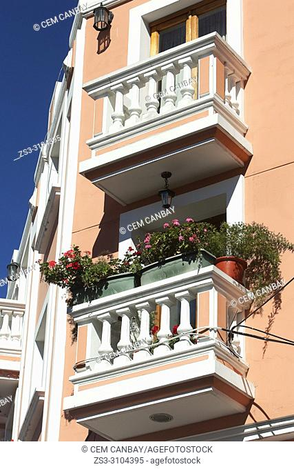Balconies with colorful geranium flowers at the Plaza Santo Domingo Square in the historic center, Quito, Ecuador, South America