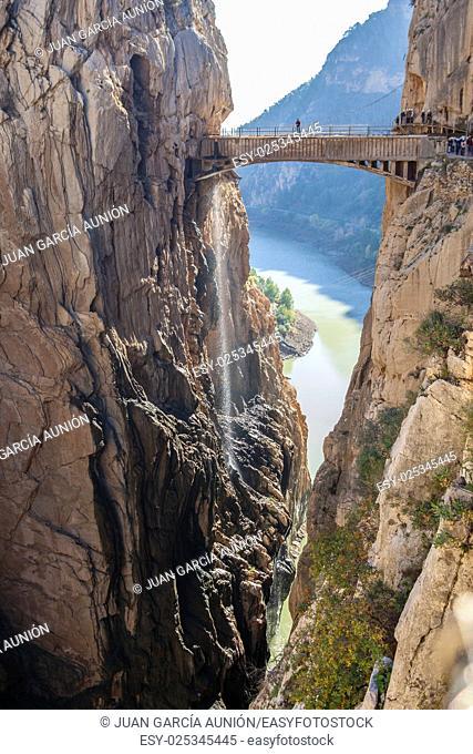 Visitors crossing the suspension bridge at Gaitanes Gorge, Malaga, Spain