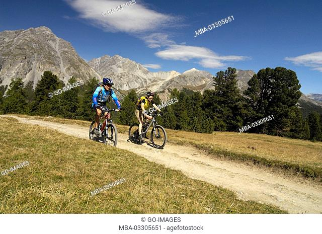 Mountain biker close Tschierv, Canton of Grisons, Switzerland