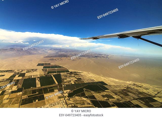 Airplane view of the flat fields on the way to the Nazca Lines
