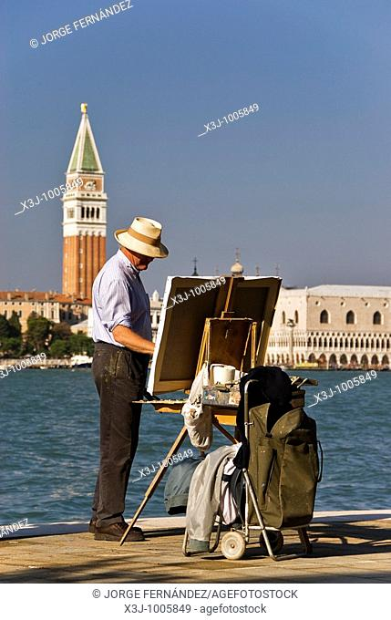 Painter working by the venetian canals with the Campanile in view, Venice, Italy, Europe