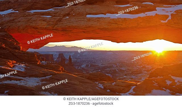 Sunrise and sunbeam at Mesa Arch, Canyonlands National Park, USA