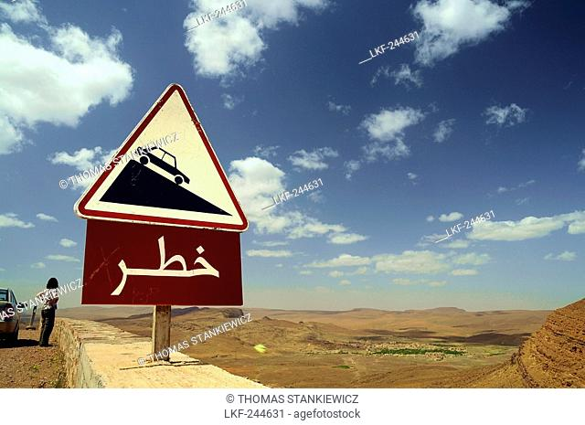 Traffic sign at Tinififft-pass under clouded sky, Draa valley, South Morocco, Morocco, Africa