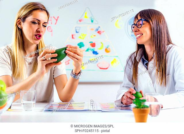Nutritionist with female patient