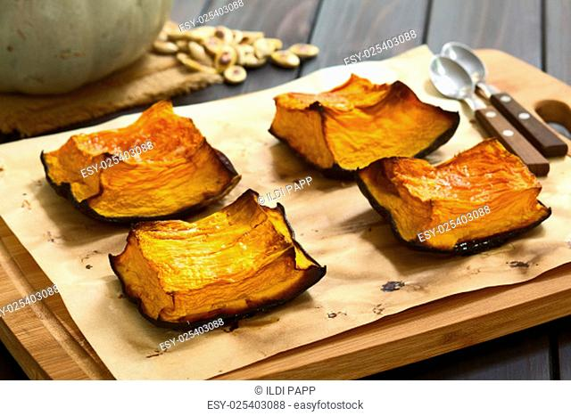 Baked pumkin pieces with caramelized sugar on top, a traditional autumn snack in Hungary, photographed with natural light (Selective Focus