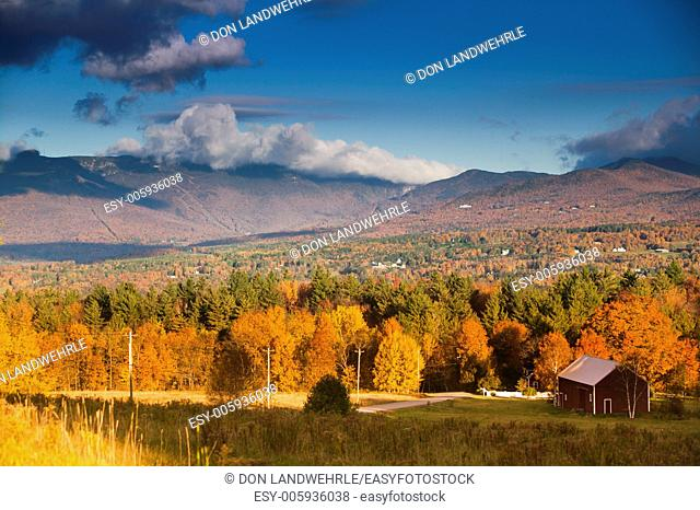 Fall foliage landscape with Mt. Mansfield in the background, Stowe, Vermont, USA