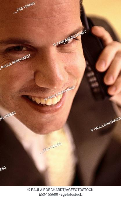 Executive talking on cell phone