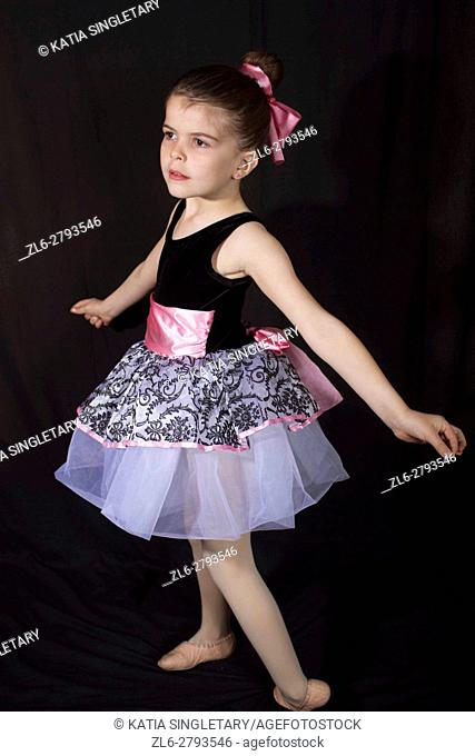 Little girl in her dancing outfits pose and have fun afront of the camera