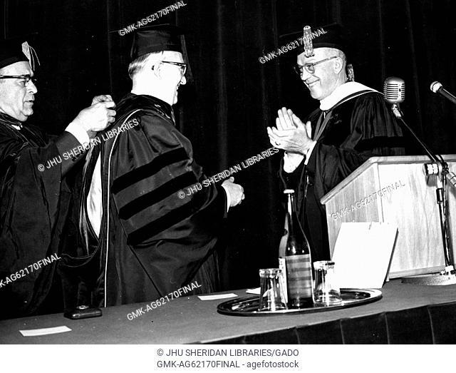 Bologna Center, SAIS, Milton Stover Eisenhower, Eisenhower applauding after awarding diploma at ceremony marking 10th anniversary of Bologna Center, 1965