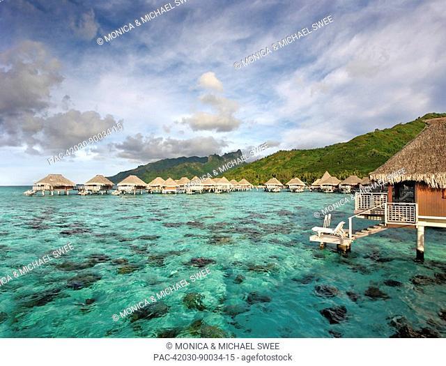 French Polynesia, Moorea Lagoon Resort, Bungalows over beautiful turquoise ocean