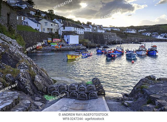 The picturesque fishing cove at Coverack on Cornwall's Lizard Peninsula, captured from the harbour slipway on an afternoon in late April