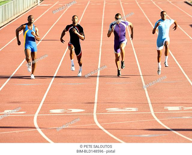 Runners running on track in race