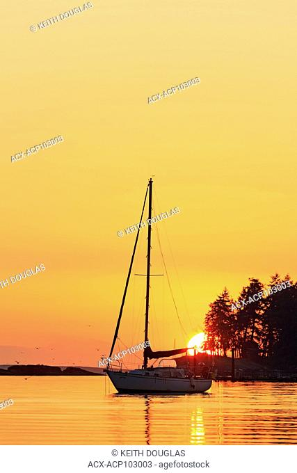 Sailboat at sunrise, Departure Bay, Nanaimo, Vancouver Island, British Columbia
