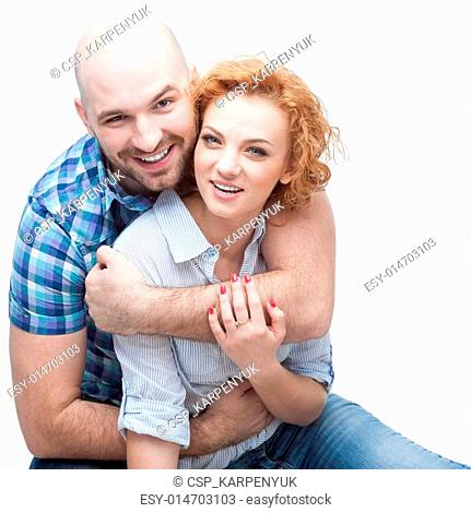 cheerful hugging couple