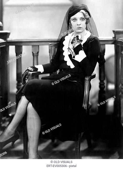 Young woman sitting in a courtroom All persons depicted are not longer living and no estate exists Supplier warranties that there will be no model release...
