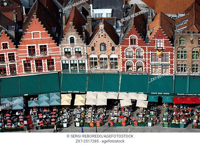 Row of ornate historic buildings in Market Square in Bruges in Belgium. On the Southern side of the Market several medieval-looking houses can be seen