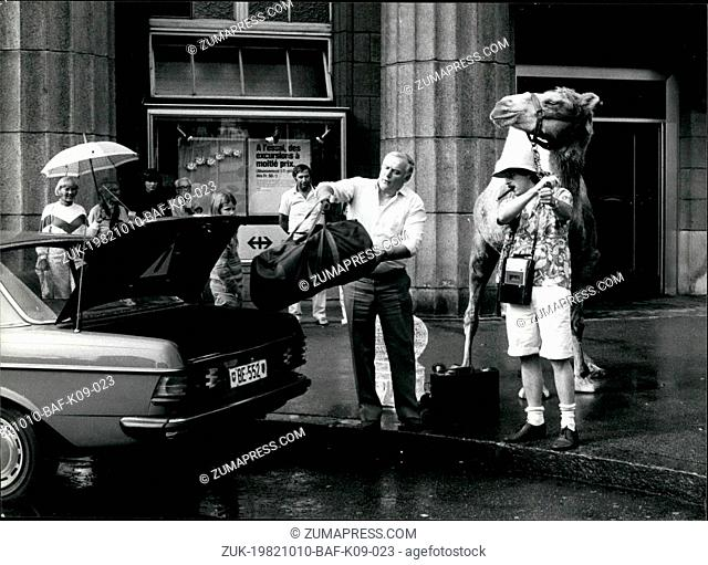 Oct. 10, 1982 - Tourists and their souvenirs: Why not a camel? Passers-by didn't believe their eyes when a man obviously coming back from a holiday in Middle...