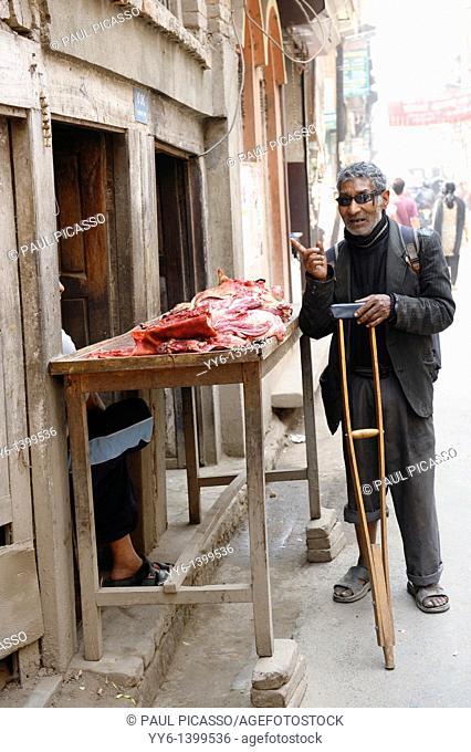 disabled blind man buying meat from street butcher , the nepalis , life in kathmandu , kathmandu street life , Nepal