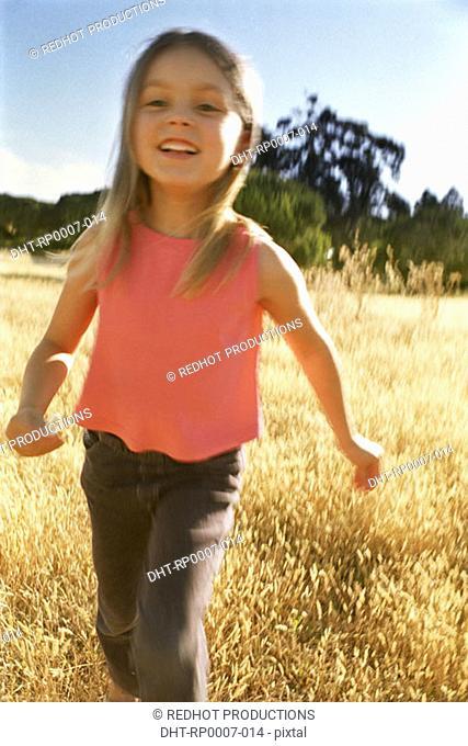 Young girl walking in field