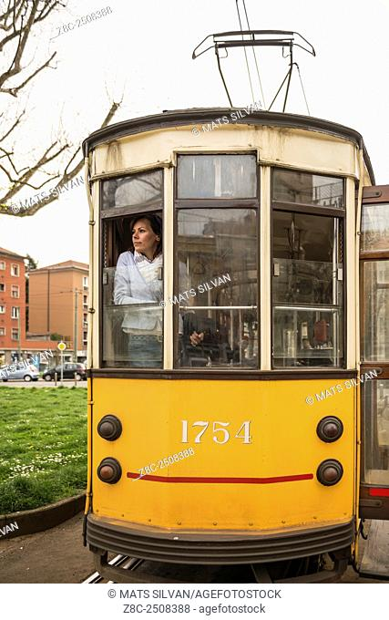 Woman travel in a tram and looking out from the window in Milan, Italy