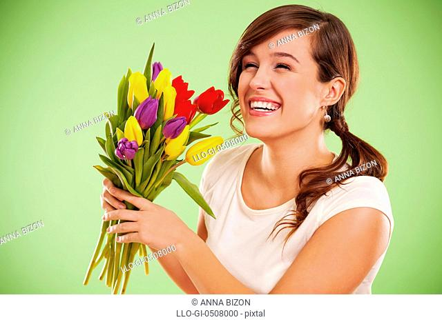 Laughing woman with tulips, Debica, Poland
