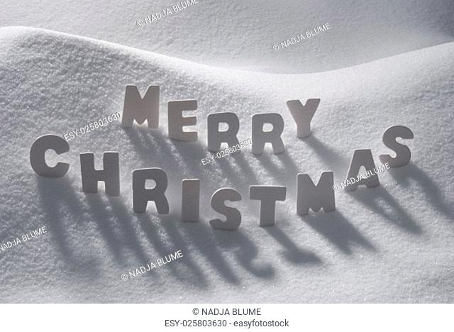 White Wooden Letters Building English Text Merry Christmas. Snow And Snowy Scenery. Christmas Atmosphere. Christmas Background Or Christmas Card For Seasons...