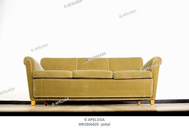 Sofa against white wall