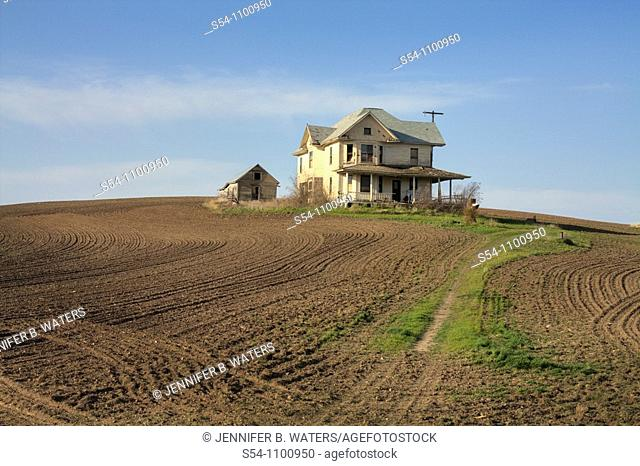A run-down old house in a farmers field in the Palouse farming area of eastern Washington