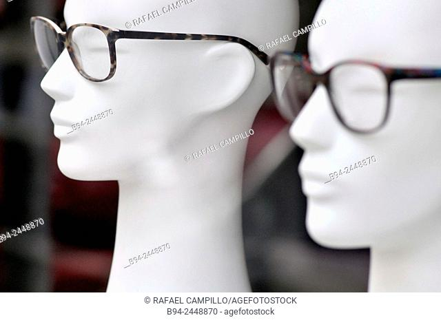 White mannequin heads with glasses