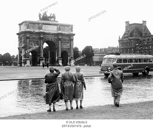 Tourists viewing the Arc de Triomphe du Carrousel at the Tuileries Gardens, July 15, 1953 All persons depicted are not longer living and no estate exists...