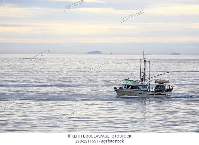 Commercial fishing gillnetter crusing to fishing grounds, Prince Rupert, British Columbia