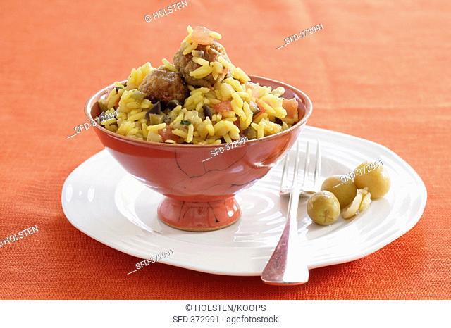 Saffron rice with aubergine and meatballs