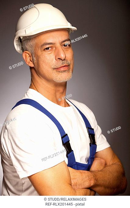 Portrait of handsome Construction worker helmet