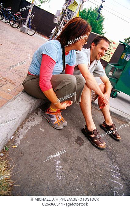 Couple at street fair. Seattle, Washington. USA