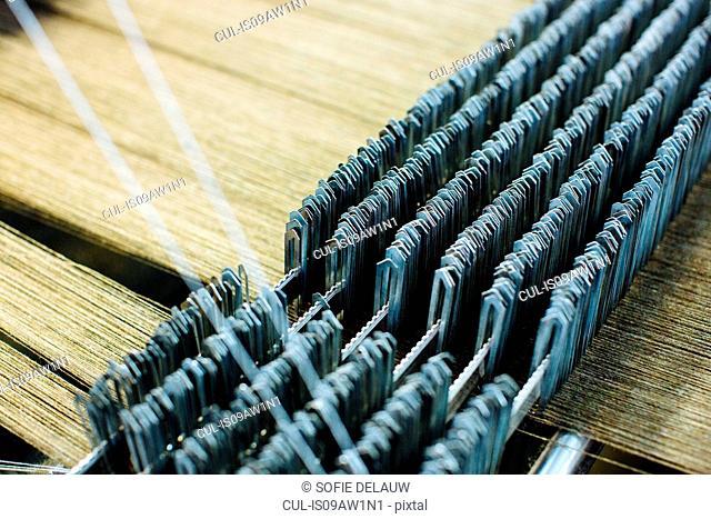 Detail of threads on weaving machine